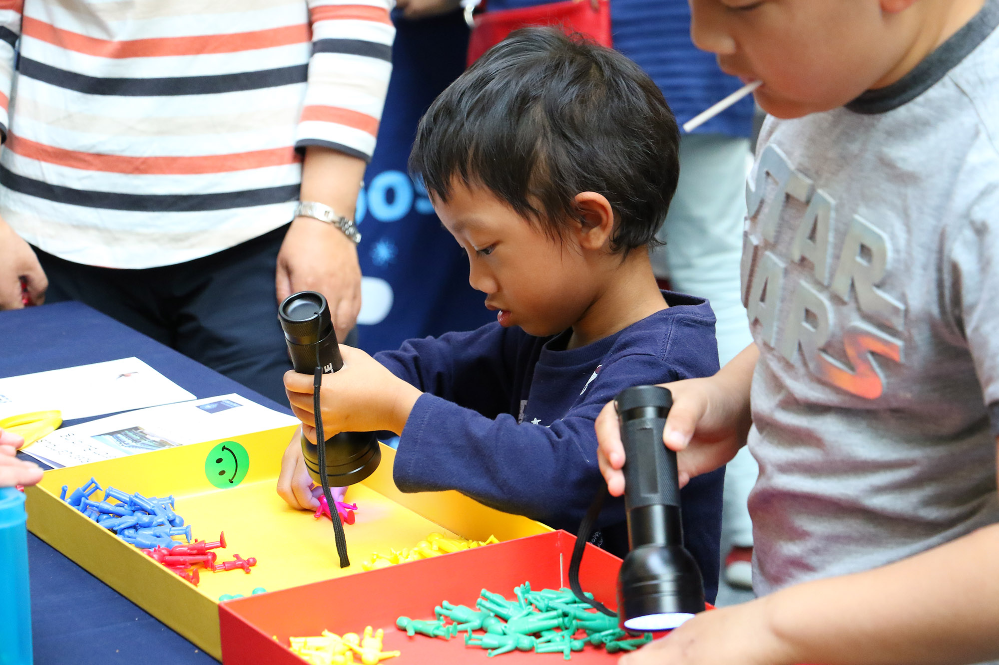 Small boy doing an activity at the 2019 Open Doors event.